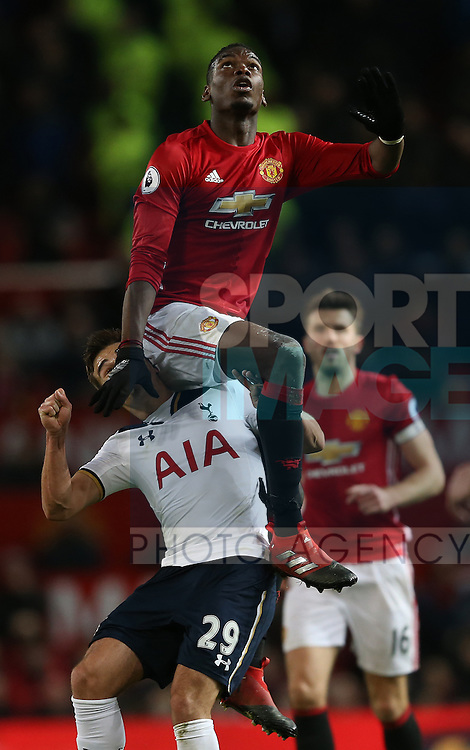 Paul Pogba of Manchester United climbs on the shoulder of Harry Winks of Tottenham during the English Premier League match at Old Trafford Stadium, Manchester. Picture date: December 11th, 2016. Pic Simon Bellis/Sportimage