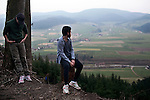 Syrian refugee Rafat Al Aydi, 20, right, takes in the view of southwestern Germany with his brother Naif, 16, during a walk in the Black Forest near their new home in the tiny village of Zell am Hammersbach, Germany, March 6, 2014. Rafat's family fled their home in besieged Yarmouk Palestinian refugee camp near Damascus after it was hit by shelling last year. Around 200,000 people are expected to apply for asylum in Germany in 2014, with an ever-increasing number coming from Syria.