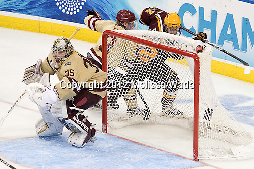 Parker Milner (BC - 35), Patch Alber (BC - 3), Travis Boyd (Minnesota - 22) - The Boston College Eagles defeated the University of Minnesota Golden Gophers 6-1 in their 2012 Frozen Four semi-final on Thursday, April 5, 2012, at the Tampa Bay Times Forum in Tampa, Florida.