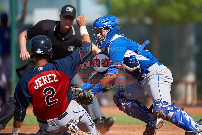 Kansas City Royals catcher Sebastian Rivero (2) tags Miguel Jerez (2) sliding into home during an Instructional League game against the Cleveland Indians on October 11, 2016 at the Cleveland Indians Player Development Complex in Goodyear, Arizona.  (Mike Janes/Four Seam Images)