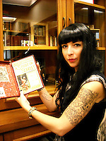 Alison Reed '08 (above) holding  the first Sherlock Holmes story, A Study in Scarlet, as presented in Beeton's Christmas Annual, from the Ned Guymon Mystery and Detective Fiction Collection.  Photo taken by Alison's friend, Tomas, on the occasion of their visit in Summer 2010.<br />
