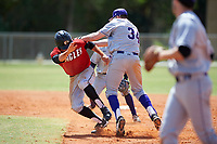 New York University Violets first baseman Colman Hendershot (34) tags out Jeff Tucker (19) during a game against the Edgewood Eagles on March 14, 2017 at Terry Park in Fort Myers, Florida.  Hendershot was ejected on the play for shoving Tucker during the tag.  NYU defeated Edgewood 12-7.  (Mike Janes/Four Seam Images)