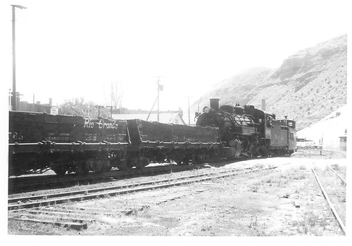 D&amp;RGW #480 helper locomotive on train of drop-bottom gondolas with caboose on end.<br /> D&amp;RGW  Durango, CO