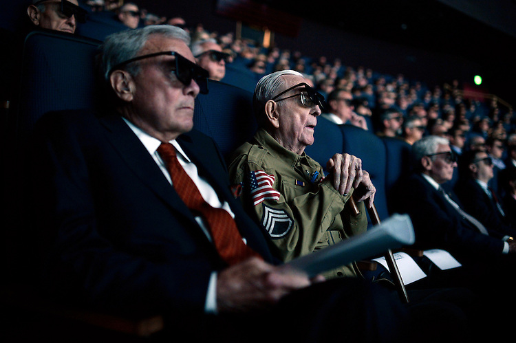 "UNITED STATES - MAY 19: Tom Brokaw and World War II veteran Tom Blakey, 93, of New Orleans, watch a screening of ""D-Day 3D: Normandy 1944,"" which Brokaw narrated, at the IMAX theater in the the Smithsonian Air and Space Museum, May, 19, 2014. Blakey jumped into Normandy on D-Day with the 82nd Airborne. (Photo By Tom Williams/CQ Roll Call)"