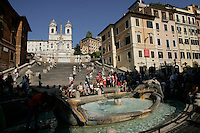 The Fontana della Barcaccia, Scalinata di Spagna and Trinità dei Monti no cimo church at Piazza Di Spagne - XVI in Rome,Italy -  1st September 2008.
