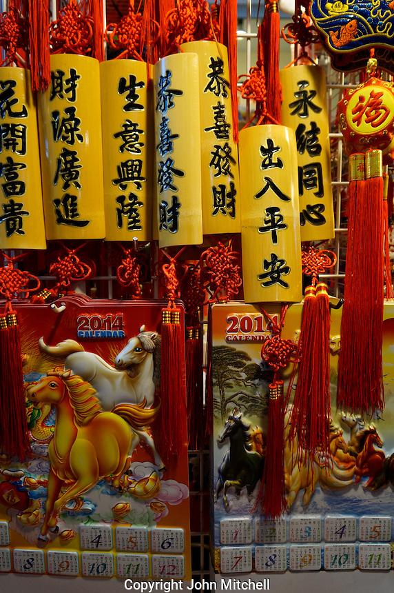 Year of the Horse calendars and decorations add  colour to Chinese New Year celebrations in Chinatown, Vancouver, BC, Canada.