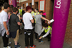 Uruguay 2 United Arab Emirates 1, Great Britain 1 Senegal 1, 26/07/2012. Old Trafford, Olympic Games. Young spectators are frisked by a security guard at the entrance to the turnstiles at Manchester United's Old Trafford stadium prior to the Men's Olympic Football tournament matches at the venue. The double header of matches resulted in Uruguay defeating the United Arab Emirates by 2-1 while Great Britain and Senegal drew 1-1. Over 72,000 spectators attended the two Group A matches. Photo by Colin McPherson.