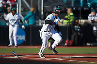 BT Riopelle (25) of the Coastal Carolina Chanticleers starts down the first base line against the Illinois Fighting Illini at Springs Brooks Stadium on February 22, 2020 in Conway, South Carolina. The Fighting Illini defeated the Chanticleers 5-2. (Brian Westerholt/Four Seam Images)