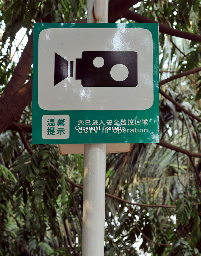 "CCTV cameras are positioned all around the city od Sh, Shenzhen, China.   The city is the test ground for a ""Golden shield"" surveilance system that plan to use face recognition data along with other biometric data to keep a tab on the country's citizens."