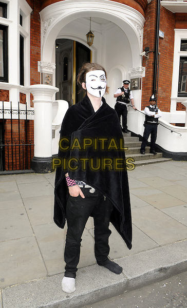 Julian Assange supporters continue to demonstrate in front of the Ecuadorian Embassy in Knightsbridge, London, England..August 23rd 2012.gv general full length black cape guy fawkes mask .CAP/BK/PP.©Bob Kent/PP/Capital Pictures