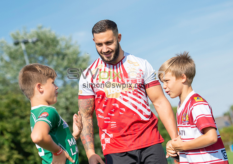 Picture by Allan McKenzie/SWpix.com - 25/07/2018 - Rugby League - Dacia Flair Play - New Spring Lions & Ince Rose Bridge RLFC, Ince-in-Makerfield, England - Romain Navarrete with participants.