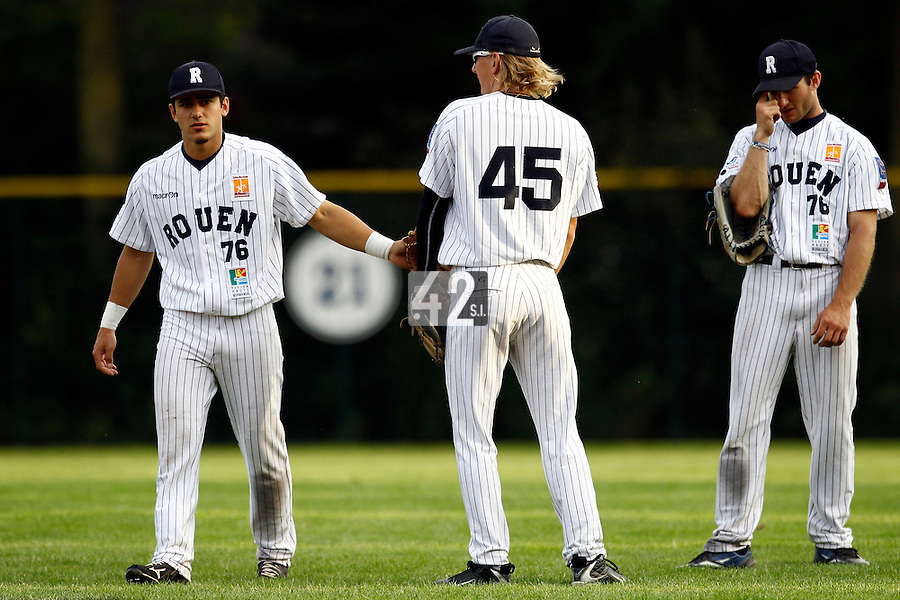 15 July 2011: Maxime Lefevre of the Rouen Huskies is seen next to Luc Piquet and Joris Bert during the 2011 Challenge de France match won 6-5 by the Rouen Huskies over the Senart Templiers at Stade Pierre Rolland, in Rouen, France.