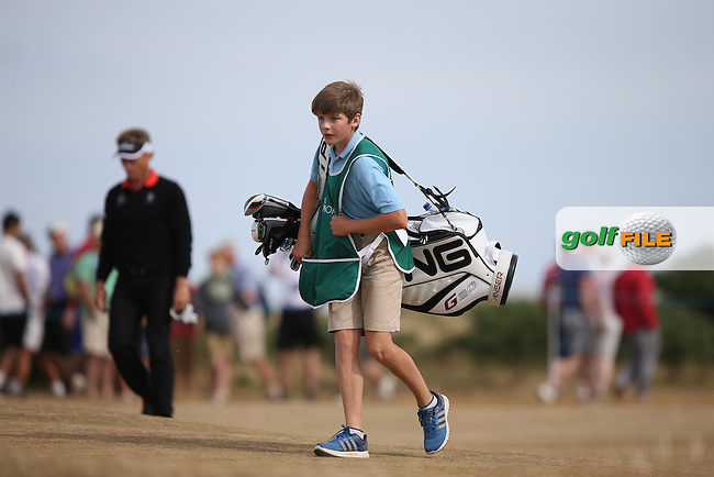 Harry Evans, the son of Peter Evans the Pro at Royal Porthcawl, carried the bag for Rick Gibson (CAN) throughout the 2014 Senior Open Championship presented by Rolex from Royal Porthcawl Golf Club, Porthcawl, Wales. Picture:  David Lloyd / www.golffile.ie