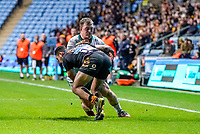 5th January 2020; Ricoh Arena, Coventry, West Midlands, England; English Premiership Rugby, Wasps versus Northampton Saints; Zach Kibirige of Wasps puts in a big hit on Alex Waller of Northampton Saints - Editorial Use