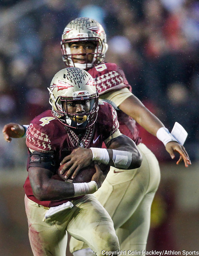 Florida State University Seminoles quarterback Jameis Winston watches as Dalvin Cook takes the handoff against the Boston College Eagles during the football game in Tallahassee, Florida on November 22, 2014. <br />