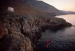Crete, Greece, Sea Kayakers explore the southwest coast, Mediterranean Sea, Europe, Greek Orthodox chapel, Feathercraft breakdown aluminum and fabric sea kayaks, sunrise,.
