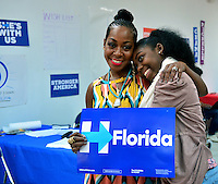 MIAMI GARDENS, FL - AUGUST 06: Tichina Arnold and daughter Alijah Kai Haggins visit the Hillary for Florida Volunteers Phone Bank and Voter Registration Drive at the Florida Democratic Party Miami Gardens office on Saturday, August 6, 2016 in Miami Gardens, Florida. Credit: MPI10 / MediaPunch