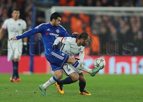 09.03.2016. Stamford Bridge, London, England. Champions League. Chelsea versus Paris Saint Germain. Chelsea Forward Pedro wins the ball from Paris St. Germain Midfielder Lucas
