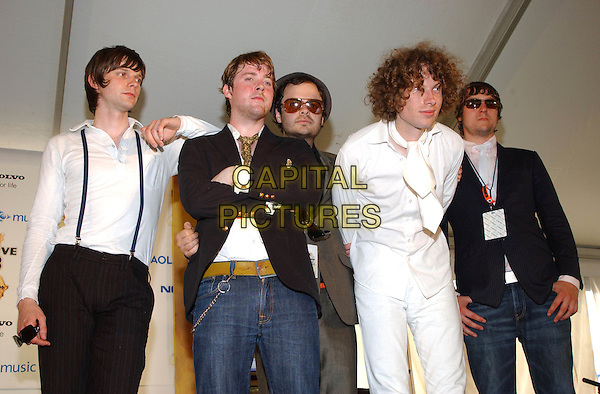 KAISER CHIEFS.Live 8 Pressroom - Philadelphia, Pennsylvania.Live 8 is a series of nine concerts on four continents the same day to raise awareness to call for an end to extreme poverty in Africa.  .July 2nd, 2005.Photo Credit: George Shepherd/AdMedia.half length arms crossed sunglasses shades leaning bending over sunglasses shades.www.capitalpictures.com.sales@capitalpictures.com.© Capital Pictures.