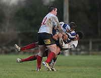 4th January 2014; Dave Panter, Corinthians, is tackled by, Mark Gribben and Michael Barker, Malone. Ulsterbank League Division 1B, Corinthians RFC v Malone RFC, Corinthian Park, Galway. Picture credit: Tommy Grealy/actionshots.ie.