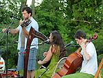 Violinist, Charlie Schikowitz, Harpist, Elizabeth Clark-Jerez, and Cellist, Sharon Penz, of Mamalama, performing at Saugerties Sunset Concert at Glasco Mini Park, NY on Friday, July 1, 2011. Photo © Jim Peppler 2011.