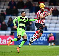 Lincoln City's Michael Bostwick clears under pressure from  Forest Green Rovers' Tahvon Campbell<br /> <br /> Photographer Andrew Vaughan/CameraSport<br /> <br /> The EFL Sky Bet League Two - Lincoln City v Forest Green Rovers - Saturday 3rd November 2018 - Sincil Bank - Lincoln<br /> <br /> World Copyright © 2018 CameraSport. All rights reserved. 43 Linden Ave. Countesthorpe. Leicester. England. LE8 5PG - Tel: +44 (0) 116 277 4147 - admin@camerasport.com - www.camerasport.com