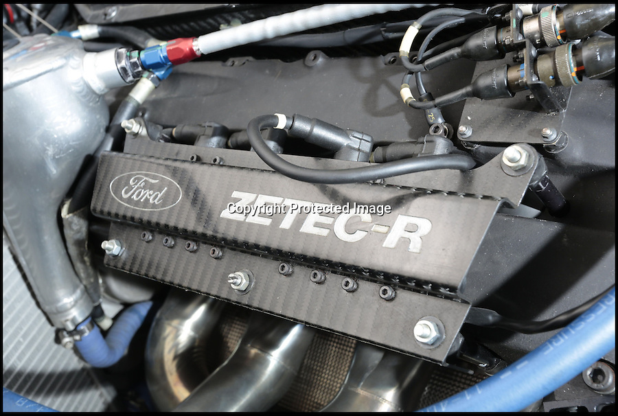 BNPS.co.uk (01202 558833)<br /> Pic: Bonhams/BNPS<br /> <br /> ***Please use full byline***<br /> <br /> Ford Cosworth Zetec engine...<br /> <br /> One of the most historic F1 cars of all time is coming up for auction - with a glorious but poignant heritage.<br /> <br /> Its the Benetton F1 car which helped rising star Michael Schumacher win his first world championship in 1994.<br /> <br /> The German driver won four Grand Prix in this 1994 Benetton Cosworth Ford B194, including the famous Monaco race.<br /> <br /> But despite the historic car's successful history, it is linked to one of the darkest moments in motor racing history.<br /> <br /> Schumacher was driving this car immediately behind rival Ayrton Senna when the Brazilian driver was killed in a horrific 190mph crash at the Imola circuit in the 1994 San Marina GP.<br /> <br /> Schumacher climbed out of the vehicle moments after the accident and went on to win the race when it controversially restarted.<br /> <br /> The 200mph car is in perfect working order although you will need a F1 circuit to run the 3.5 litre 740bhp monster.<br /> <br /> Bonhams are selling the historic motor with a pre-sale estimate of £600,000.