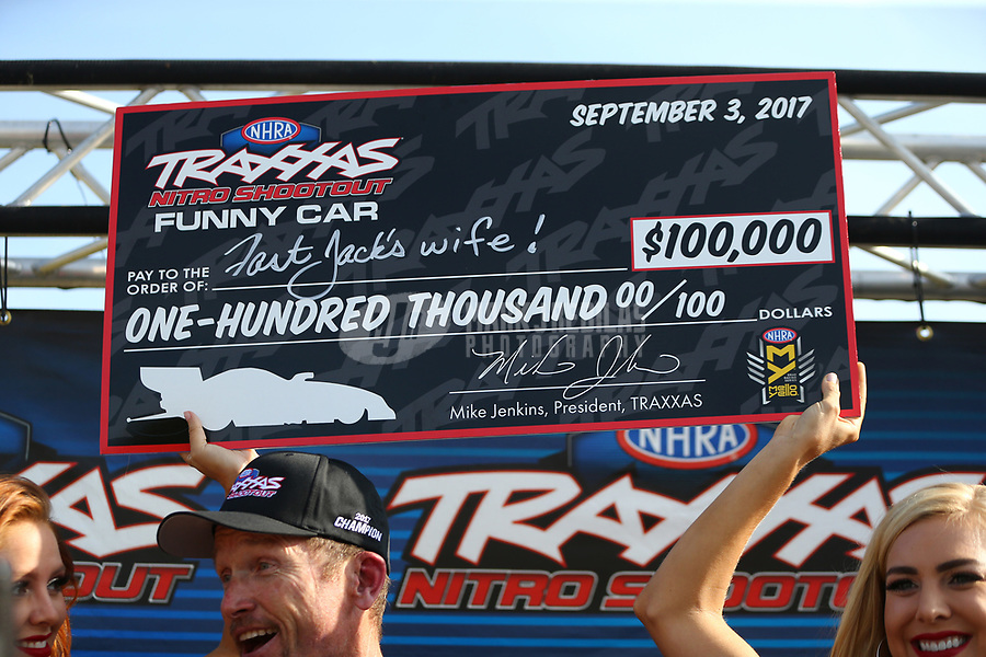 Sep 3, 2017; Clermont, IN, USA; NHRA funny car driver Jack Beckman celebrates with the check after winning the Traxxas Shootout specialty race during qualifying for the US Nationals at Lucas Oil Raceway. Mandatory Credit: Mark J. Rebilas-USA TODAY Sports