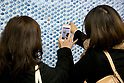 "Pedestrians take a photograph of a wall of 100,000 Slime characters in Shinjuku Station on February 26, 2015. 100,000 Blue Slime from the game of Dragon Quest are displayed in bubble-wrap in a corridor of Shinjuku Station. The wall was created to promote the newest video game ""Dragon Quest Heroes: The Dark Dragon and the World Tree Castle"" for Playstation 3 and 4. Passersby can pop the Slimes and the goal of for all 100,000 bubbles to have been burst by the end of the campaign. There are special characters such as metal Slimes and Rockbombs hidden along the wall and the installation is accompanied by background music from the game. The promotion runs from February 23rd to March 1st in Tokyo. (Photo by Rodrigo Reyes Marin/AFLO)"