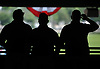 A trio of spectators view the track from the grandstand during the morning hours of the 150th running of the Belmont Stakes on Saturday, June 9, 2018