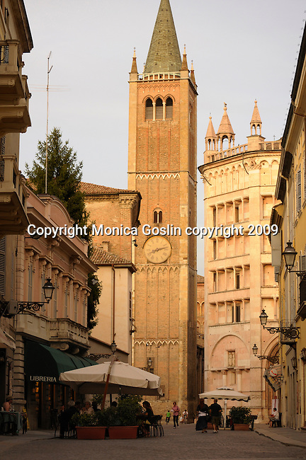 Bell Tower of the San Giovanni Evangelista Church, late mannerist style dating back to 1604 and the Baptistery (on the right) in Parma, Italy; the Baptistery is an octagonal shape and filled with 13 and 14 century frescoes and paintings