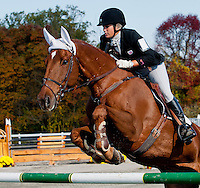 Sir Donovan, with rider Katie Ruppel (USA), competes during the Stadium Jumping test during the Fair Hill International at Fair Hill Natural Resources Area in Fair Hill, Maryland on October 21, 2012.