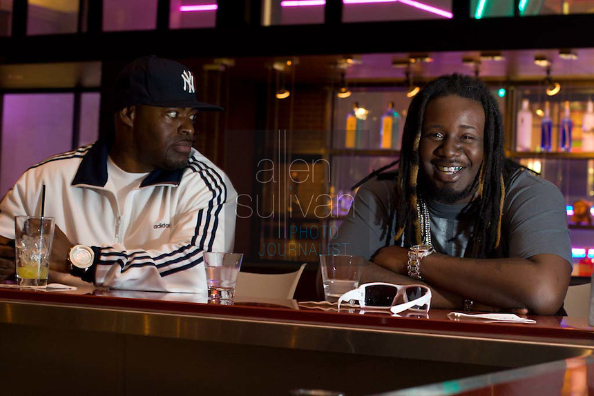 "Rapper and R & B artist T-Pain (right), whose ""Buy U a Drank (Shawty Snappin')"" has hit the top of the charts, and his manager, Chris Boogie, at Strip Steaks and Sushi in Atlanta, Georgia on Wednesday, May 23, 2007."