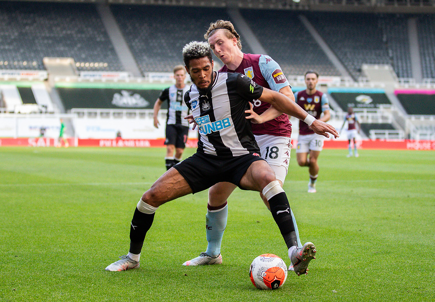 Newcastle United's Joelinton shields the ball from Aston Villa's Matt Targett<br /> <br /> Photographer Alex Dodd/CameraSport<br /> <br /> The Premier League - Newcastle United v Aston Villa - Wednesday 24th June 2020 - St James' Park - Newcastle <br /> <br /> World Copyright © 2020 CameraSport. All rights reserved. 43 Linden Ave. Countesthorpe. Leicester. England. LE8 5PG - Tel: +44 (0) 116 277 4147 - admin@camerasport.com - www.camerasport.com
