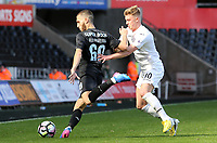 SWANSEA, WALES - MARCH 25: Rui Moreira of Porto is closely marked by Adam King of Swansea City during the Premier League International Cup Semi Final match between Swansea City and Porto at The Liberty Stadium on March 25, 2017 in Swansea, Wales. (Photo by Athena Pictures)