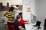 BROOKLYN -- APRIL 22, 2011: Studiomates gather around Tina Roth Eisenberg's computer in their workspace on April 22, 2011 in Dumbo, Brooklyn.   (PHOTOGRAPH BY MICHAEL NAGLE)