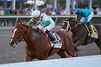 HALLANDALE BEACH, FL - MAR 3:  Promises Fulfilled #10 with jockey Irad Ortiz Jr on board, wins the Fountain of Youth GII Stakes, at Gulfstream Park on March 3, 2018 in Hallandale Beach, Florida. (Photo by Liz Lamont/Eclipse Sportswire/Getty Images)