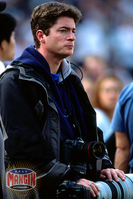 OAKLAND, CA - Photographer Jed Jacobsohn takes a break at during a game between the New York Jets and Oakland Raiders on January 6, 2002 at the Oakland Coliseum in Oakland, California. (Photo by Brad Mangin)