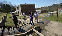 NWA Democrat-Gazette/ANDY SHUPE<br /> Deniece Smiley (left), Fayetteville Housing Authority director, leads a tour Friday, March 30, 2018, of Willow Heights, a property that the authority directs, for the organization's board of directors and members of the public in Fayetteville. The board this year has to come up with a capital improvements plan, per U.S. Department of Housing and Urban Development regulations.