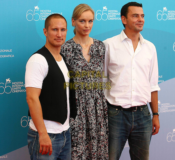 "CHRISTIAN PETZOLD, NINA HOSS & BENNO FURMANN.""Jerichow"" Photocall during the 65th Venice Film Festival, Venice, Italy..August 28th, 2008.half length pattern print dress black white red jeans denim waistcoat shirt.CAP/ADM/Liverani/LG.©Luca Ghidoni/Liverani/AdMedia/Capital Pictures"