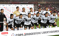 BOGOTA -COLOMBIA, 9-07-2013. Formación del Olimpia del Paraguay durante el encuentro con Santa Fe , partido de la semifinal de la Copa Bridgestone  Libertadores de América , jugado en el estadio Nemesio Camacho El Campín de la ciudad de Bogotá./   Training Olimpia of Paraguay during the meeting with Santa Fe, semifinal match of the Copa Libertadores Bridgestone, played at the Estadio Nemesio Camacho El Campin in Bogota<br /> . Photo: VizzorImage/ Felipe Caicedo/ STAFF