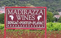 Sign saying Madirazza Wines, Dingac, Portup, Plavac. Potmje village, Dingac wine region, Peljesac peninsula. Dingac village and region. Peljesac peninsula. Dalmatian Coast, Croatia, Europe.
