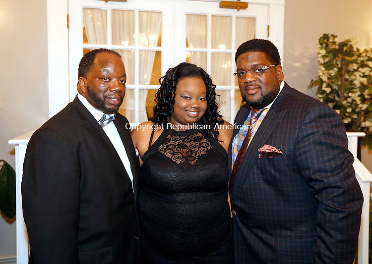 Wolcott, CT- 18 December 2015-121815CM13- Social moments, from left to right, Edward Barnes who along with his wife, Tina Barnes, sponsored the event, their daughter, Amanda Barnes, of Waterbury and pastor Charles Brewer of New Haven are photographed during a Christmas Holiday Ball,  at Crystal Gardens in Wolcott on Friday December 18, 2016. The dinner buffet is sponsored by The Greater Evangel Temple C.O.G.I.C in Ansonia.   Christopher Massa Republican-American