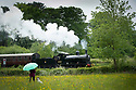 27/05/17<br /> <br /> As Bank Holiday Monday rain showers fall, a girl and her dog watch an L&YR Class 27 steam train pulling out of Idridgehay station on the Ecclesbourne Valley Railway, near Wirksworth in the Derbyshire Dales.<br /> <br /> All Rights Reserved, F Stop Press Ltd +44 (0)7765 242650 www.fstoppress.com rod@fstoppress.com