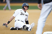 Michael Ludowig (22) of the Wake Forest Demon Deacons slides into third base during the game against the Sacred Heart Pioneers at David F. Couch Ballpark on February 15, 2019 in  Winston-Salem, North Carolina.  The Demon Deacons defeated the Pioneers 14-1.  (Brian Westerholt/Four Seam Images)