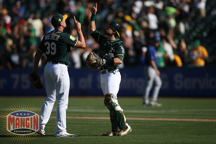 OAKLAND, CA - SEPTEMBER 8:  Blake Treinen #39 of the Oakland Athletics celebrates with teammate Jonathan Lucroy #21 after the game against the Texas Rangers at the Oakland Coliseum on Saturday, September 8, 2018 in Oakland, California. (Photo by Brad Mangin)