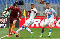 Roma&rsquo;s Kevin Strootman, right, is challenged by Napoli&rsquo;s Faouzi Ghoulam, center, and Marek Hamsik, during the Italian Serie A football match between Roma and Napoli at Rome's Olympic stadium, 4 March 2017. <br /> UPDATE IMAGES PRESS/Riccardo De Luca