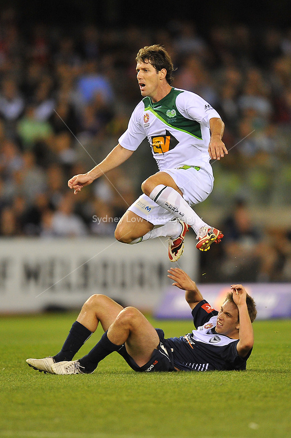 MELBOURNE, AUSTRALIA - FEBRUARY 5, 2010: Evan Berger from Melbourne Victory lies on the ground as Robbie Middleby from Queensland Fury jumps over him in round 26 of the A-league match between Melbourne Victory and North Queensland Fury at Etihad Stadium on February 5, 2010 in Melbourne, Australia. Photo Sydney Low www.syd-low.com