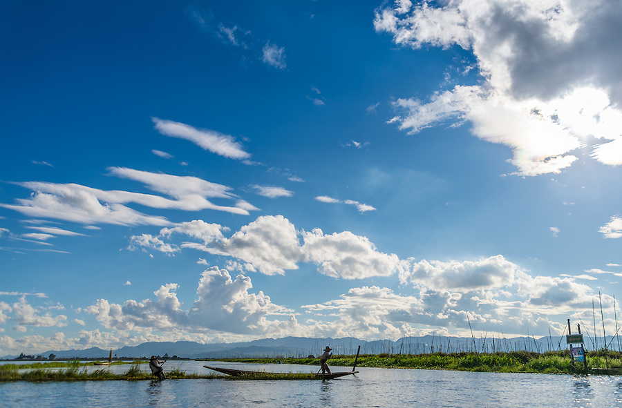 INLE LAKE, MYANMAR - CIRCA DECEMBER 2013: Men working on floating islands in Inle Lake.