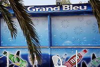 "France. Alpes-Maritimes province.  Antibes. Marineland. A closed shop "" Le Grand Bleu"" ( in memory of the movie from Luc Besson). Marketing for Perrier and San Pellegrino water bottles. Perrier Fluo (cherry ginger, pepermint) is a soft drink brand. Perrier and competitor San Pellegrino are owned by the Nestlé Corporation. Drawings from various circle of killer whales on the shop window. The killer whale (Orcinus orca), commonly referred to as the orca whale or orca, and less commonly as the blackfish, is a toothed whale belonging to the oceanic dolphin family. Killer whales are regarded as apex predators, lacking natural predators. Marineland is an animal exhibition park and receives more than a million visitors per year. 03.11.06 © 2006 Didier Ruef"